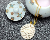 Porcelain necklace, white with gold star pattern, carved
