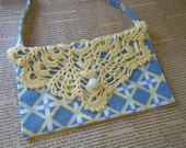 Graphic blue yellow and green clutch with yellow crocheted doily flap