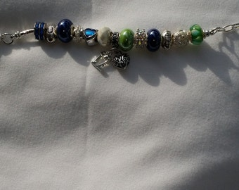 12th Man Celebration with this European Style bracelet with bling and porcelin charms, Seahawk colors and The #12 Charm.