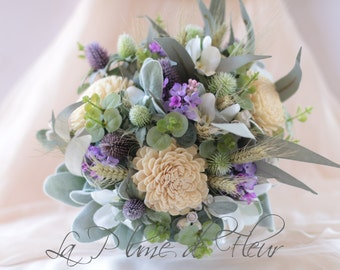 Amity - Bridal bouquet, country garden.  Cream, mauve and green.  Thistle, lilac, flannel flowers, berries, wheat, sola flowers and foliage.