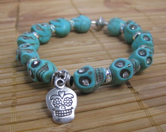 Rhinestone sugar skull charm bracelet made with turquoise magnesite gemstone skulls and silver plated rhinestone rondelles