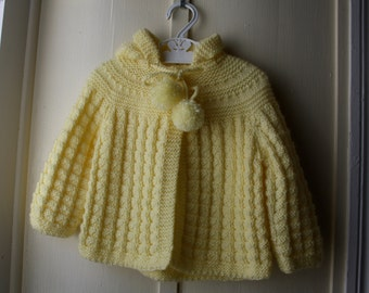 Vintage handknit yellow hooded sweater with pompoms / lemon yellow cardigan sweater / baby girl 6-12 months