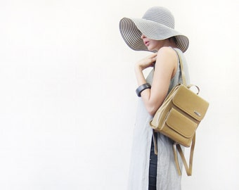 Vintage olive yellow leather small minimalist backpack bag