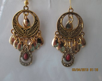 Gold Tone chandelier Earrings with Gold Tone Teardrop Dangle one with Red Center