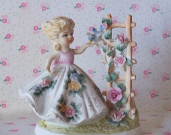 Lefton Hand Painted Girl with Blue Bird by Trellis