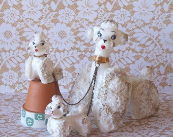 Vintage Lefton Spaghetti Poodle and Puppies on chain
