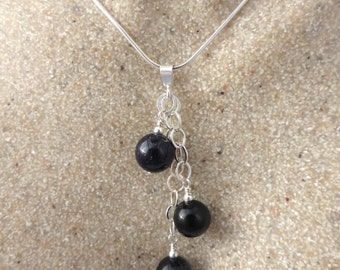 Blue goldstone and silver pendant