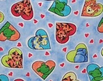 Fabric Animal Friends features a blue background with colorful hearts, each framing animals: lions, tigers, giraffes, bears