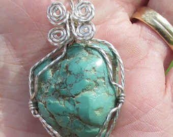 Natural Turquoise Nugget   in silver wire
