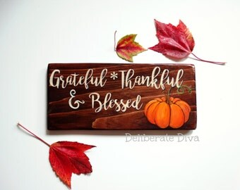 """Wooden Thanksgiving sign hand painted over dark stained wood """"Grateful Thankful and Blessed"""" with a pumpkin"""
