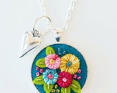 Vibrantly Colored Hand Embroidered Necklace Pendant Jewelry - Hand Stitched Flowers on Teal Background - Silver Frame