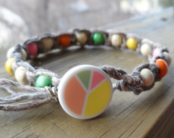 Natural Hemp Bracelet with Pastel wood beads and Peace Sign button clasp