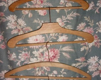 4 old wood hangers