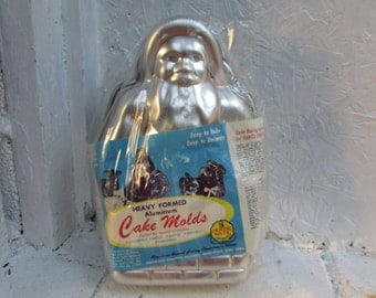 VINTAGE Nordic Santa Claus Heavy Formed Aluminum Cake Mold.  NOS. Sealed in Original Package.  Nice Condtion. Vintage Christmas.