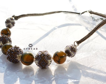 15.10.1 Coral Echo - necklace in lavendar and bronze