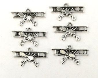 6 retro airplane charms silver tone, 15mmx 28mm # CH 307