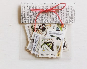 Vintage postage stamps pretty light coloured paper bird & butterfly mix stamp collection