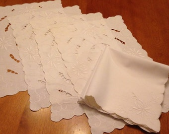 Set of Four White Cutwork and Embroidered Placemats and Matching Napkins