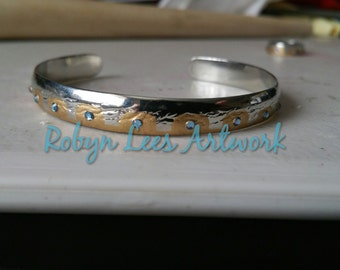 Hand Painted Chakram Style Bangle Bracelet in Silver with Gold Enamel and Light Blue Rhinestones. Xena Inspired