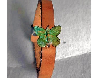 leather wrist cuff with patina butterfly charm