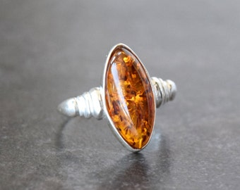 Elegant sterling silver ring with Baltic amber