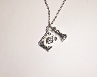 """Cover of """"Breaking Dawn"""" book pendant inspired by the Twilight saga"""