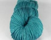 TL;DR: 438 yards 75/20/5 Superwash Merino/Nylon/Stellina fingering weight yarn in Luminosity yarn base.
