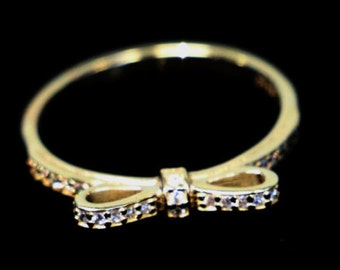 14 kt Gold and CZ Bow Ring