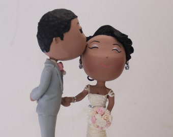 Cute kiss on the cheek. Groom hiding phone on his back. Wedding cake topper. Handmade. Fully customizable. Unique keepsake
