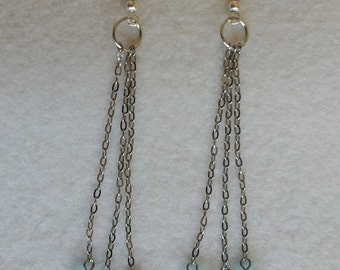 Sterling silver earrings with long chain and glass beads.