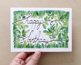 HAPPY BIRTHDAY. Calligraphic card and foliage. Elegant and vegetal card. Watercolor.