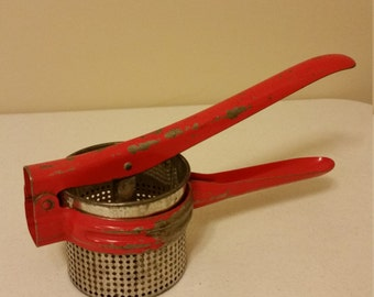 vintage potato ricer food strainer masher juicer - red metal by handy things company ludington mi - colander basket kitchen utensil decor