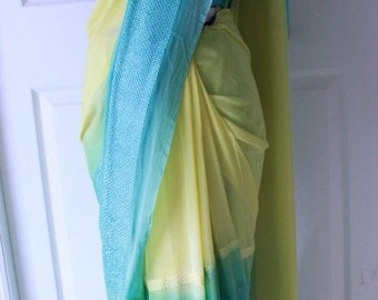 Falling saree with a mix of yellow and sea green with contrast blouse