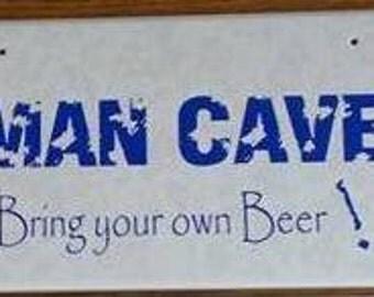 Man Cave vinyl on ceramic tile plaque