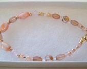 Pink and Gold Bracelet