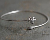 NEW: Delicate silver fox bangle. Fox head and tail. Hand patinated and enameled. Adjustable wrap bangle.