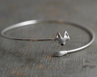 Delicate silver fox bangle. Fox head and tail. Hand patinated and enameled. Adjustable wrap bangle.