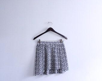 Geo Pattern Pleated Mini Skirt
