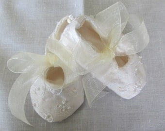 Silk baby shoes with embroidery and pearls and organza ribbon ties