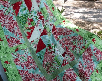Sale: Kate Spain Christmas mini quilt.  Beautiful designer fabrics create a warm quilt for the holidays.