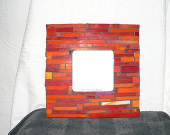 Handmade picture frames all carefully made of stained glass and easily mounted on walls