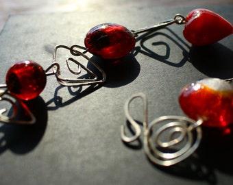 Chunky red glass bead bracelet with geometric wire links