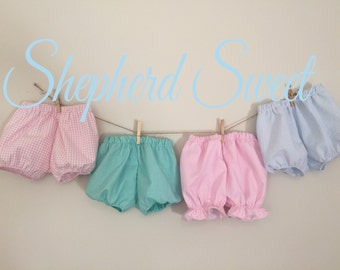 Little girls bubble and ruffle bloomers, knickers, diaper covers.
