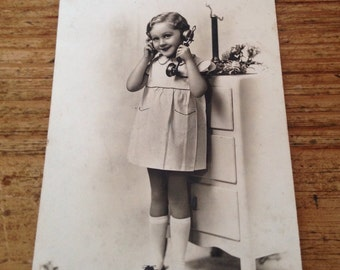Vintage French sepia photograph - girl on phone