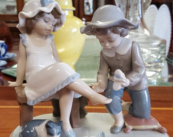 Try This One Girl & Boy Shoe Fitting Lladro Figurine