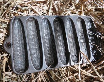 Small vintage cast iron corn pans
