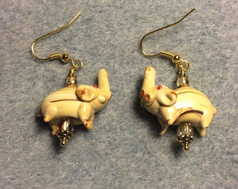 Tan striped lampwork elephant bead earrings adorned with tan Czech glass beads.