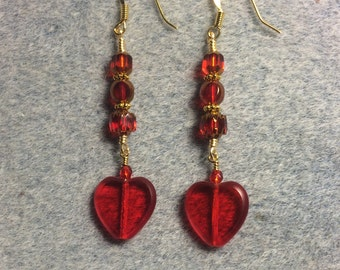 Translucent red Czech glass heart bead dangle earrings adorned with bright red Czech glass beads.