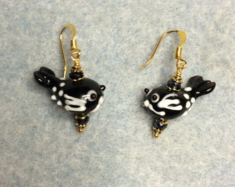Black and white lampwork flying fish bead earrings adorned with black Chinese crystal beads.