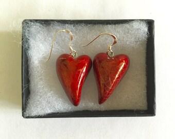 Red heart earrings.